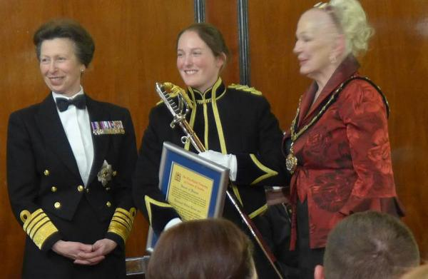 HRH Princess Royal hands the Joint services sword of honour to Captain Gillian Turner, Royal Logistics Corps.