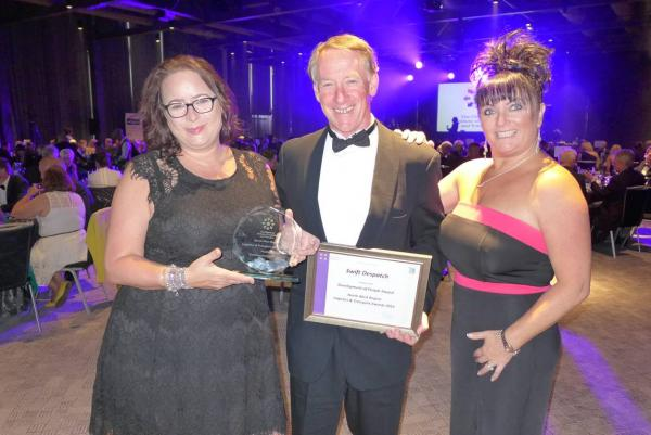 Vince Friery, Debbie Charlton, Zoe Eaton Swift despatch holding the glass for North West transport awards