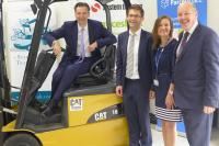 Heathrow boss John Holland-Kaye takes to the fork truck at the Logistics Skills Centre with West Thames principal Tracy Aust and Inst of Couriers chair carl Lomas