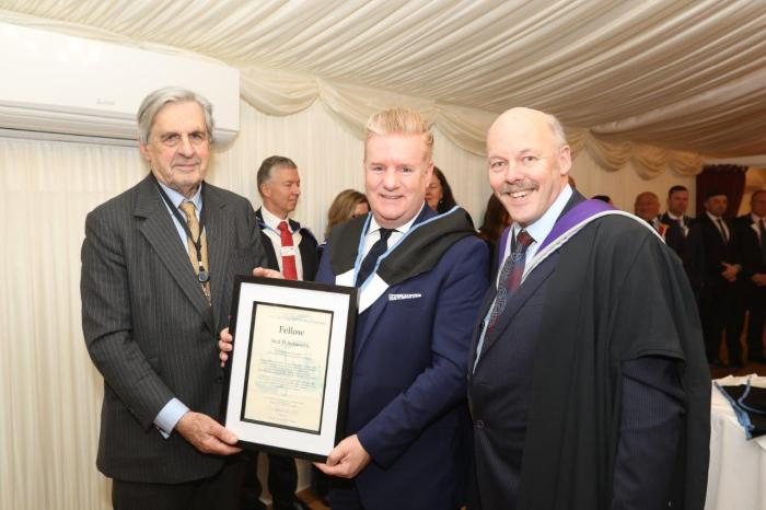 2019 news mar fellows gowning fellow neil ashworth