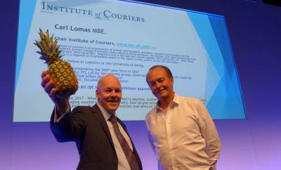 Quentin Wilson introduced Carl Lomas IoC chair to the Microlise Coventry Ricoh Arena 2017 transport conference, pineapple and all !