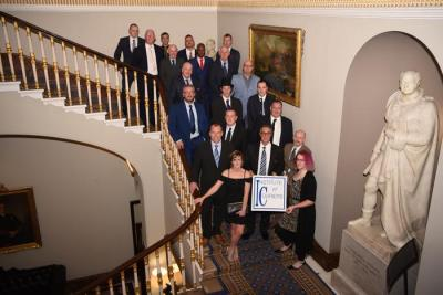 The 2017 shortlisters for the 21st National Courier Awards gather on the staircase at the Institute of Directors in Pall Mall, London