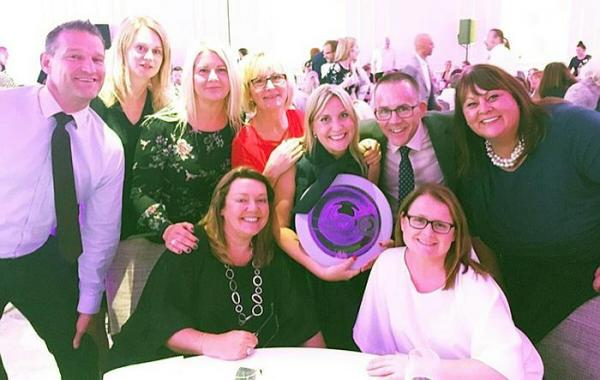 Faye Calland (centre) and the TNT team celebrate her win at the Everywomen in Transport Awards