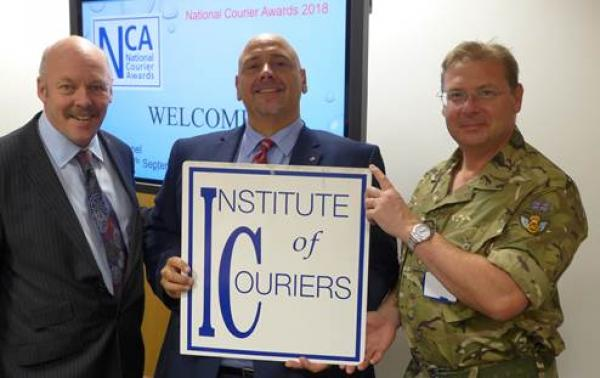 Adrian Smith takes centre stage with army postal boss, Colonel Andy Moffat BFPO RLC and IOC chair Carl Lomas
