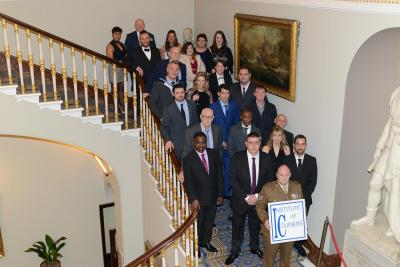 The 2016 shortlisters for the 20th National Courier Awards gather on the staircase at the Institute of Directors in Pall Mall, London