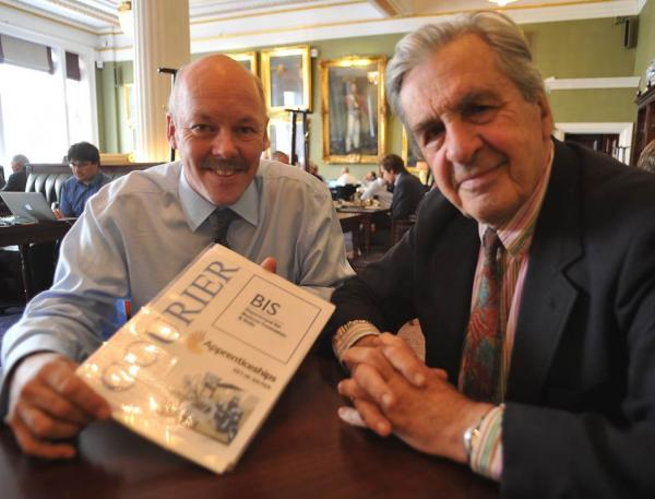 Institute of Couriers  chairman, Carl Lomas with IOC president, Viscount Lord Falkland, celebrate the Courier express manager degree paperwork at the IoD