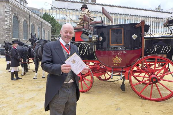Carl Lomas with the Royal Mail stagecoach in Guildhall Yard