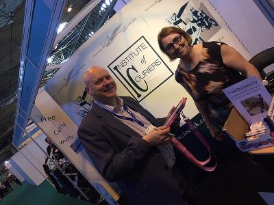 Philip Wood from Cadbury logistics celebrates Curly Wurly hand-out at IOC Multimodal stand for 'What is logistics ?' engagement