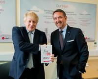 Boris Johnson MP with DPD boss Dwain McDonald at their Middleton depot during the General Election campaign 2019
