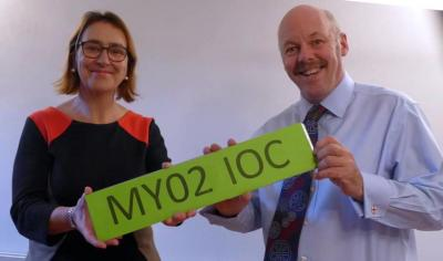Tracey Worth and Carl Lomas grab a green plate for the DfT number plate news